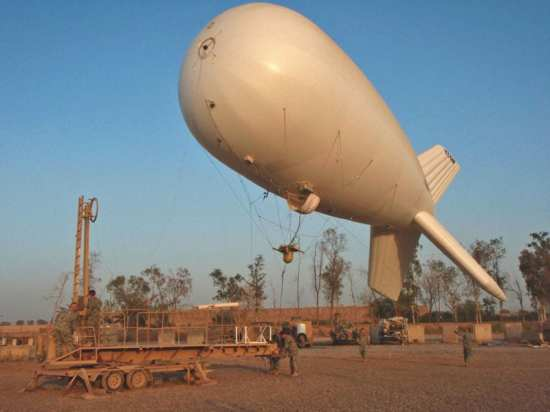 Soldiers of Headquarters, Headquarters Troop, 1st Squadron, 152nd Cavalry, 76th Infantry Brigade Combat Team (Indiana Army National Guard) prepare to moor a RAID aerostat at Camp Liberty, Baghdad.  U.S. Army photo.