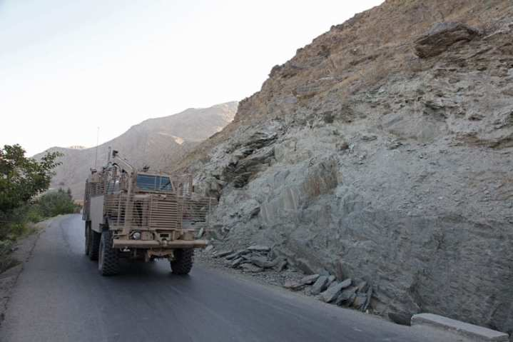 """A U.S. Army Buffalo MRAP vehicle equipped with """"bar armor"""" from Alpha Company, Brigade Special Troops Battalion, 3rd Brigade Combat Team, 10th Mountain Division, clears Route Georgia of improvised explosive devices (IED) during a route clearance mission in the Wardak Province of Afghanistan, Aug. 28, 2009.  U.S. Army photo by Sgt. Teddy Wade."""