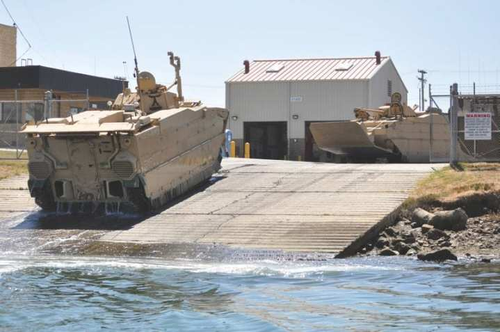Two of seven new EFV SDD-2 prototypes at the Marine Corps' Amphibious Vehicle Test Branch (AVTB), Camp Pendleton, Calif., prepare to undergo Developmental Testing. Photo courtesy of EFV Program Office.