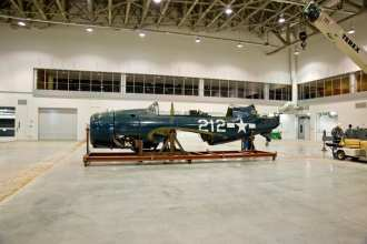 The SB2C-5 Helldiver is the first aircraft to be moved into the Phase 2 Mary Baker Engen restoration hangar at the National Air and Space Museum's Udvar-Hazy Center. NASM photo By Dane A. Penland.