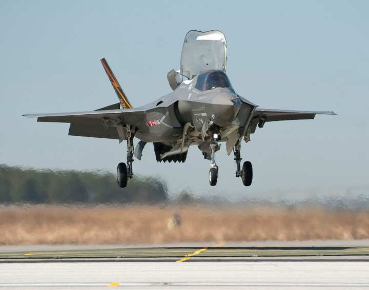 """Pilot Graham Tomlinson takes the F-35B in for its first vertical landing in 2010. Secretary of Defense Robert Gates has put the F-35B STOVL version of the JSF on """"probation"""" because of his concerns for the variant's progress toward IOC. Lockheed Martin photo"""