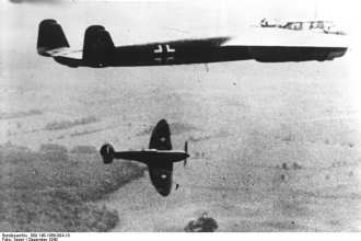 A Spitfire breaks below and away from a Dornier 17