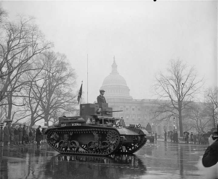 The latest types of tanks from the year 1939 rumble past the Capitol in the Annual Army Day Parade in Washington, D.C. The tanks were preceded by 20,000 soldiers and veterans, who paraded past the U.S. Capitol in the Annual Army Day Parade, which marked the 22nd anniversary of America's entry into World War I. Thousands braved a heavy downpour to view the parade. LIbrary of Congress photo