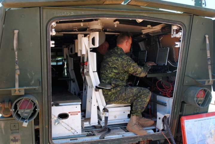 Canadian command vehicle with operators and laptops disseminating ISR information during Exercise Empire Challenge '11. Photo by Scott R. Gourley