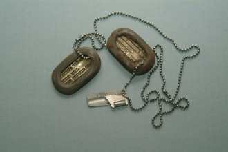 P-38 Can Opener On Dog Tag