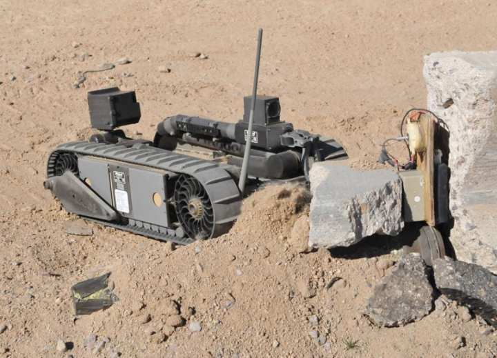 Soldiers from the 1st Stryker Brigade Combat Team (SBCT), 25th Infantry Division, use the iRobot 510 PackBot® to identify and unarm a simulated improvised explosive device (IED) at the Robotics lane located at the U.S. Army's National Training Center (NCT) in Fort Irwin, Calif., February 2011. The 510 PackBot is used by infantry soldiers to identify roadside bombs and other IEDs. For the soldiers on the front lines, the robot allows them to assess areas from a safe distance. Soldiers from the 1/25th SBCT were conducting a wide variety of training at NTC in preperation for their deployment to Afghanistan. U.S. Army photo by Spc. Thomas Duval 1/25th SBCT PAO