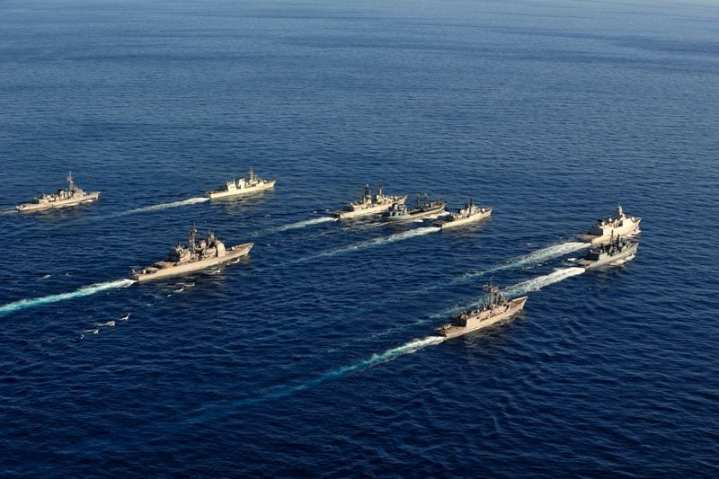 The NATO surface fleet engaged in Exercise Proud Manta 2012 steams in formation. Clockwise from top left: USS De Wert (FFG 45), FGS Rheinland Pfalz (F 209), HNLMS De Ruyter (F 804), FGS Rhön (A 1443), ITS Espero (F 576), ITS Francesco Mimbelli (D 561), HMCS Charlottetown (FFH 339), FS Jean de Vienne (D 643), and USS Vella Gulf (CF 72). Photo by Cpl Ronnie Kinnie, Royal Canadian Navy
