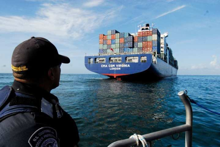A member of the U.S. Customs and Border Protection (CBP) agency looks toward the CMA CGM Virginia, a container shipping vessel, May 16, 2009, off the coast of Jacksonville, Fla., before boarding the ship to search for possible stowaways. CBP worked with Coast Guard Sector Jacksonville'€™s boarding team to conduct a search after the ship'€™s captain reported finding unfamiliar backpacks containing food and water on the ship'€™s bow. CBP is the Department of Homeland Security's lead agency for cargo security and has authority over cargo and crew once a vessel arrives in port. U.S. Coast Guard photo by Petty Officer Cindy Beckert