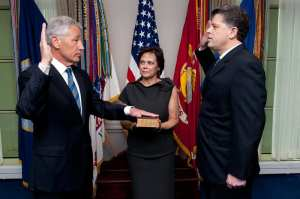 Lilibet Hagel, center, holds the Bible for her husband Chuck Hagel, left, as he is sworn into office as the 24th Secretary of Defense by DoD Director of Administration and Management Michael L. Rhodes, right, in the Pentagon on Feb. 27, 2013. DoD photo by Petty Officer 1st Class Chad J. McNeeley, U.S. Navy