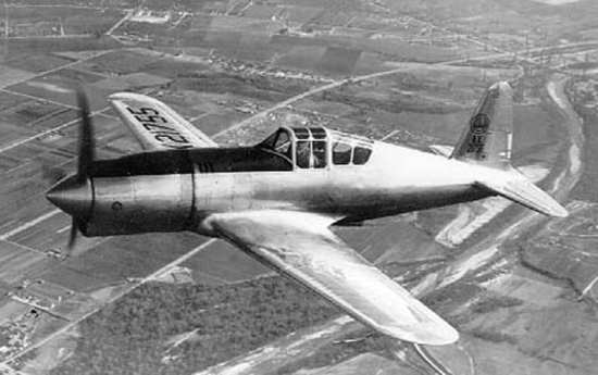 Vultee Model 48 in flight with original long cowling
