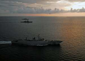 The guided-missile destroyers USS Fitzgerald (DDG 62) and USS McCampbell (DDG 85) maneuver with the Chinese People's Liberation Army Navy (PLAN) destroyer Guangzhou off the coast of North Sulawesi, Indonesia, following an international fleet review that commemorated the 64th anniversary of Indonesian independence, Aug. 19, 2009. Fitzgerald and McCampbell are part of Destroyer Squadron 15 and the USS George Washington Carrier Strike Group underway supporting security and stability in the western Pacific Ocean. The United States will have to decide to either work with rising powers or to retrench. U.S. Navy photo by Mass Communication Specialist 3rd Class Ian Schoeneberg