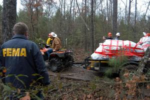 FEMA officials transport the shuttle Columbia's nosecone from the woods near Hemphill, Texas, Feb. 4, 2003. FEMA photo by Mark Wolfe