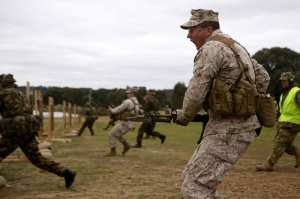 """U.S. Marine Corps Sgt. Jonathan Shue prepares to bayonet a target, Puckapunyal, Australia, May 15, 2012. """"There is nothing that a Marine wants to hear more than 'fix bayonets' and nothing that the enemy fears more,"""" said Shue. U.S. Marine Corps photo by Lance Cpl. Mark W. Stroud"""