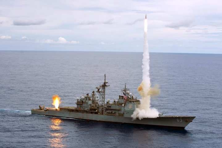 The Ticonderoga-class guided-missile cruiser USS Cowpens (CG 63) fires Standard Missiles (SM) 2 at an airborne drone during a live-fire weapons shoot, Sept. 20, 2012. Cowpens was part of the George Washington Carrier Strike Group, the U.S. Navy's only forward deployed carrier strike group, and was conducting a routine patrol of the western Pacific region. U.S. Navy photo by Mass Communication Specialist 3rd Class Paul Kelly