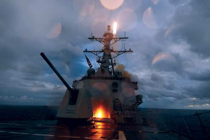 The guided-missile destroyer USS Mustin fires Standard Missile 2 missiles from the ship's decks during a missile exercise in the Pacific Ocean, Sept. 20, 2012. The Mustin is one of seven guided missile destroyers assigned to Destroyer Squadron 15 and is forward deployed to Yokosuka, Japan. U.S. Navy photo by Mass Communication Specialist 2nd Class Devon Dow