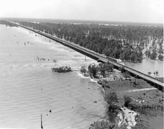 The Bonnet Carré Spillway in operation. Mississippi River, La., 1973. Photo courtesy of Office of History, Headquarters, U.S. Army Corps of Engineers