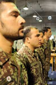 Afghan air force pilot candidates stand at attention during an official ceremony recognizing their efforts in the AAF Conference Center, Kabul, Afghanistan, Nov. 17, 2011. The resolution of the Light Air Support contract means the Afghan Air Force can start to remedy a capabilities gap. U.S. Air Force photo by Staff Sgt. Matthew Smith