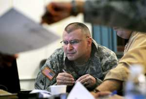 """Col. Thomas Brittain, Joint Base Lewis-McChord commander, watches his base's Facebook news feed at Joint Base Lewis-McChord, Wash., March 1, 2012. """"Social media has clearly become the environment in which our service members and families communicate,"""" Brittain said. U.S. Army photo by Scott Hansen"""
