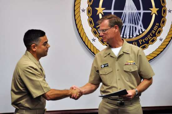 Capt. John Lemmon (left) is congratulated by Rear Adm. Donald Gaddis, program executive officer for Tactical Aircraft Programs (PEO(T)), after assuming command as program manager for the Hawkeye, Advanced Hawkeye and Greyhound Program Office (PMA-231), Naval Air Systems Command, Paxtuxent River, Md., May 29, 2012. U.S. Navy photo.