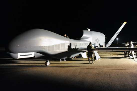 Airmen work on an RQ-4 Global Hawk after it returned to Beale Air Force Base, Calif., as part of a four-ship rotation out of the theater, Sept. 18, 2008. Unmanned Aerial Vehicles (UAVs) promise a new approach to aerial reconnaissance. U.S. Air Force photo by John Schwab