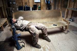 A Marine assigned to Fox Company, 2nd Battalion, 7th Marine Regiment (2/7), takes a nap in the Morale Welfare and Recreation (MWR) center on Forward Operating Base Now Zad, Helmand province, Afghanistan, Dec. 17, 2012. The MWR is a place where Marines can relax and use telephones and computers to communicate with loved ones back home. U.S. Marine Corps photo by Cpl. Alejandro Pena