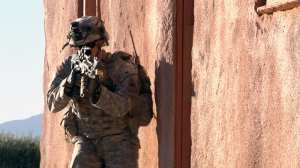 A U.S. Army soldier from 1st Battalion, 35th Armored Regiment, 2nd Brigade Combat Team, 1st Armored Division, reacts to mock opposition forces during Network Integration Evaluation 13.1, at Dona Ana Range, N.M., Nov. 19, 2012. Soldiers from 2-1 AD used NETT Warrior in scenarios designed to evaluate the benefits the portable, hand-held device provides them during dismounted operations. U.S. Army photo by Lt. Col. Deanna Bague, Brigade Modernization Command