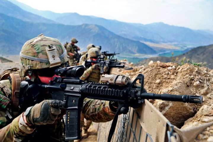 U.S. Army National Guard Spc. Timothy Shout scans the nearby ridgeline along with other members of the Provincial Reconstruction Team Kunar Security Force element, following an engagement with anti-Afghan forces. Shout was deployed from Alpha Company, 1st Battalion, 143rd Infantry (Airborne) out of Austin, Texas. The unit took small-arms fire from a nearby mountain top during a routine patrol, and was able to suppress the enemy with the assistance of local Afghan National Security Forces. U.S. Army photo