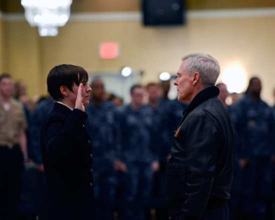 Secretary of the Navy (SECNAV) the Honorable Ray Mabus reenlists Cryptologic Technician (Collection) 2nd Class Jaella Humphey during an all-hands call, Naval Air Facility Misawa, Feb. 21, 2013. Mabus thanked Misawa Sailors for their service and sacrifice and discussed issues currently affecting the fleet, including operational and personnel matters, and the potential impacts of sequestration and continuing resolution. U.S. Navy photo by Mass Communication Specialist 1st Class Kenneth G. Takada
