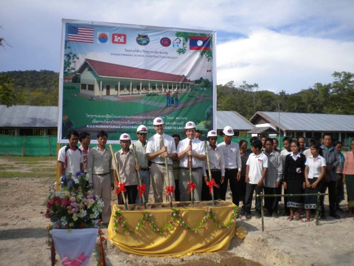 Mike MacMillan, U.S. Army Corps of Engineers (USACE) Alaska District project manager (fourth from left holding the shovel), participates in a groundbreaking ceremony for the Sanxai Primary School construction project in Attapeu province in Laos in May 2011. USACE managed the $374,407 project for the U.S. Pacific Command. The school was built under the Humanitarian Assistance Program, which marked the first time the district has managed construction projects in Asia. USACE photo