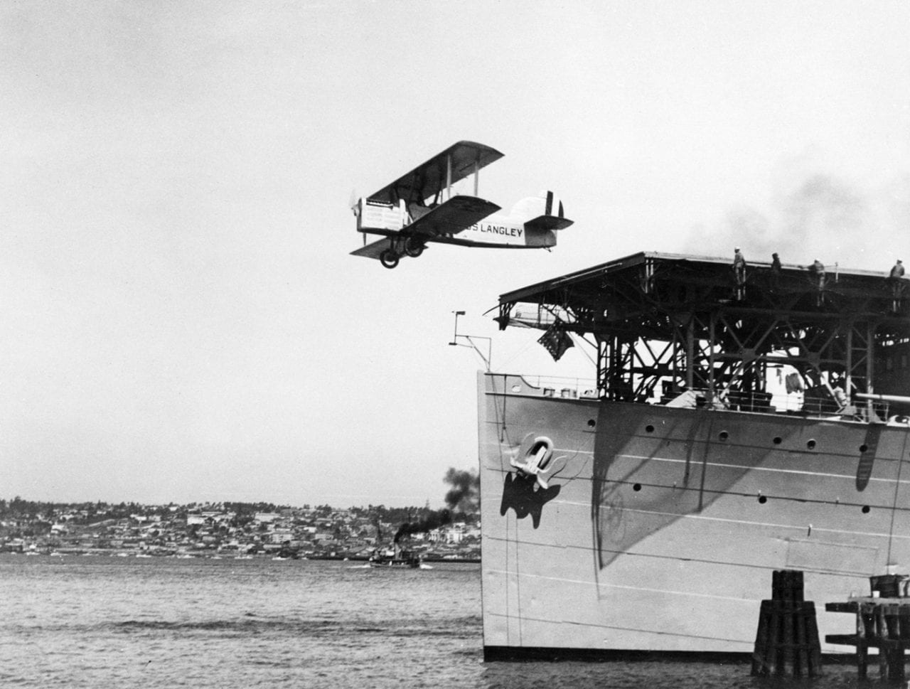 A U.S. Navy Douglas DT-2 torpedo bomber taking off from the flight deck of the aircraft carrier USS Langley (CV 1), which was docked at the carrier pier at Naval Air Station North Island, San Diego, Calif., circa 1925. This was a test to determine the feasibility of using flush-deck catapults to launch wheeled aircraft from ships. Stone served as a technical expert on naval aviation, working on catapult systems and arresting gear for Langley and the USS Lexington (CV 2) and USS Saratoga (CV 3). A U.S. Navy Douglas DT-2 torpedo bomberis catapulted from the flight deck of the Langley, which was dockedat the carrier pier at Naval Air Station North Island, San Diego, Calif.,circa 1925. This was a test to determine the feasibility of using flushdeckcatapults to launch wheeled aircraft from ships. Stone servedas a technical expert in naval aviation, working on catapult systemsand arresting gear for Langley and the USS Lexington (CV 2) andUSS Saratoga (CV 3). U.S. Naval Historical Center photo