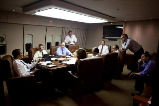 Barack Obama with staff in meeting room