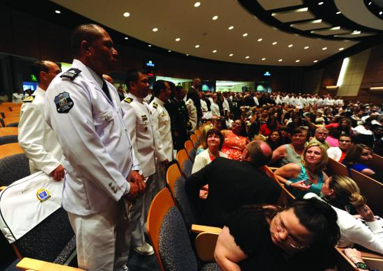 Guests watch as the U.S. Naval War College's 2013 graduating class enters Spruance Auditorium during a graduation ceremony, Newport, R.I., June 21, 2013. The graduating class of 2013 included 310 members of the U.S. Navy, U.S. Marine Corps, U.S. Air Force, U.S. Army, U.S. Coast Guard, National Guard, civilian government employees and 130 international naval officers. U.S. Navy photo by Chief Mass Communication Specialist James E. Foehl