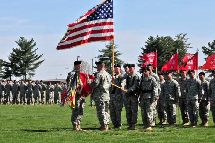 Lt. Col. Phillip J. Borders (left) receives the colors from Command Sgt. Maj. Ramon M. Fisher during the transformation ceremony of the 101st Airborne Division's 326th Engineer Battalion into the 326th Brigade Engineer Battalion (Air Assault). Photo by Sgt. 1st Class John D. Brown