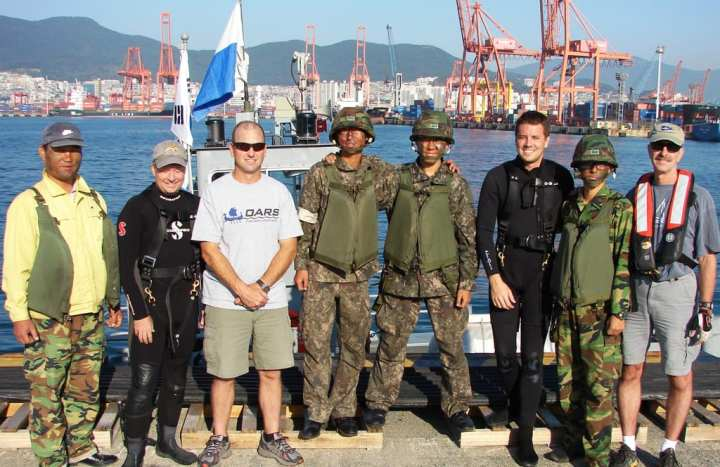 In a first-ever effort, USACE Forward Response Technical Dive Team members Shanon Chader (2nd from left); team lead Todd Manny (3rd from left); Kyle Tanner (3rd from right); and Ed Gawarecki (right) teamed up with soldiers from the Republic of Korea Army to execute an underwater inspection of Pier 8 in Busan, South Korea. Xavier Monroy photo