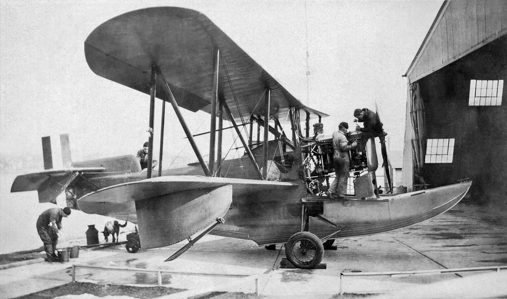 """A Loening OL-5 undergoes maintenance. Called a """"duck out of water"""" by a former Coast Guardsman, it was the first aircraft in the service to wear a Coast Guard serial number. U.S. Coast Guard Historian's Office photo"""