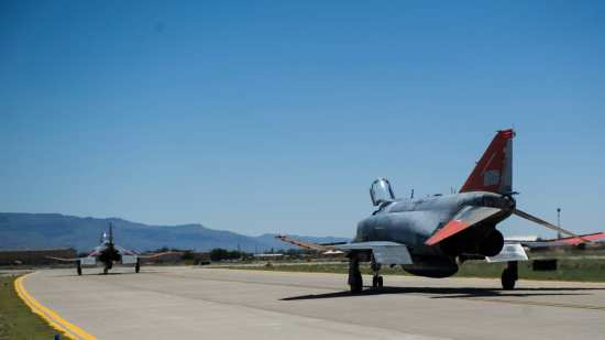 Two QF-4 Drones taxi onto the runway on June 3, 2015 at Holloman Air Force Base, N.M. Lieutenant. Col. Ronald  King, 82nd Aerial Target Squadron, Detachment 1 commander, flew the QF-4 for the first time solo. He was accompanied by James Harkins, a civilian pilot with the 82nd ATRS, Det 1, who also served as King's instructor pilot at the U.S. Air Force Academy in the 1990s and at Luke Air Force Base, Ariz. in the early 2000s. U.S. Air Force photo by Airman 1st Class Emily A. Kenney