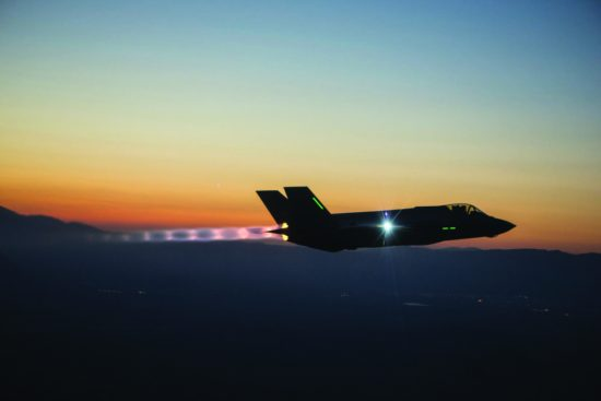 An F-35A makes a night flight in 2013. AFRL/RX developed the materials that made the f-35 possible, from it engine and structural components, to its low-observable materials and coatings. Lockheed Martin photograph by Tom Reynolds