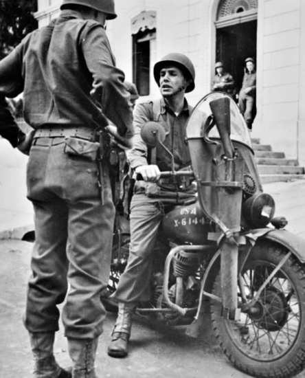 Maj. William O. Darby, commanding officer of the 1st Ranger Battalion, in Algeria, 1942. He used the motorcycle as his usual transportation around the battalion when not in combat. Note the M1903 Springfield in the motorcycle's scabbard.