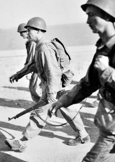 Darby's Rangers training featured extensive speed marching for all personnel, including Darby (in the middle in this photo). Arzew, 1942.