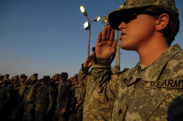 "U.S. Army Spc. Amanda Vasquez, with Headquarters and Headquarters Troop, 3rd Heavy Brigade Combat Team, 1st Cavalry Division, renders a salute during the presentation of the colors at ""Fight Night for Heroes,"" the first-ever mixed martial arts fights held at Forward Operating Base Marez, Iraq, in 2009. Today, women are one of the fastest-growing subgroups among the veteran population, according to the CWV. Photo by Senior Airman Kamaile Chan"