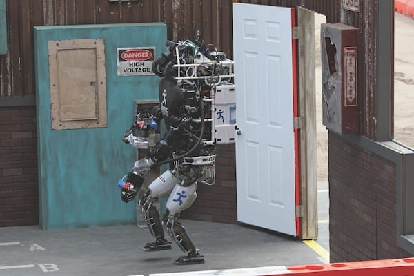 The Running Man robot of Team IHMC Robotics from Pensacola, Florida, clears a doorway during the DARPA Robotics Challenge. Twenty-five teams from around the world competed in 2015 for $3.5 million in prizes as they navigated a simulated disaster-response course. (U.S. NAVY PHOTO BY GREG VOJTKO)