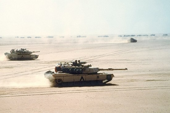 M1A1 Abrams main battle tanks and M2/M3 Bradleys of the 3rd Armored Division move out on a mission during Operation Desert Storm. The air-land battle concept was triumphant during Desert Storm, but Mosaic Warfare promises to greatly expand upon the concept, including many more systems. DOD PHOTO BY PHC D.W. HOLMES, USN