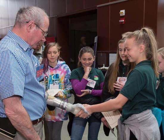 veteran with LUKE prosthetic arm DARPA web