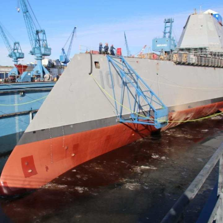 181209-N-LM768-6258 BATH, Maine (Dec. 9, 2018) Following a multi-day process that includes moving the ship from the land level facility to the dry dock, the future USS Lyndon B. Johnson (DDG 1002) is made ready before flooding of the dry dock at General Dynamic-Bath Iron Works shipyard, and subsequent launching of the third Zumwalt-class destroyer. (U.S. Navy photo courtesy of General Dynamics-Bath Iron Works/Released)