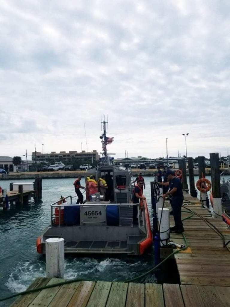 Station Key West crewmembers transfer three people to safety after rescuing them from a capsized vessel Jan. 9, 2019 approximately six miles east of Sugarloaf Key. Photo by Seaman Erik Villa Rodriguez