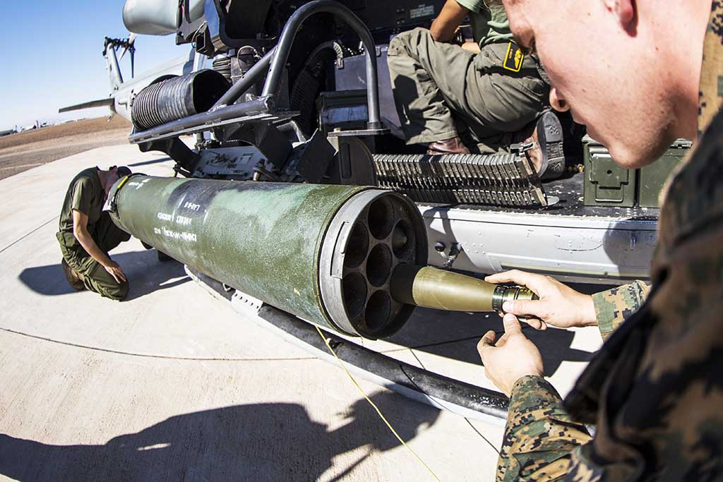 Lance Cpl. Anthony Idol loads a high explosive rocket into the LAU-68 rocket launcher of a UH-1Y Venom during Realistic Urban Training at Naval Air Facility El Centro, Calif., Nov. 10, 2018. U.S. Marine Corps photo by Cpl. Adam Dublinske