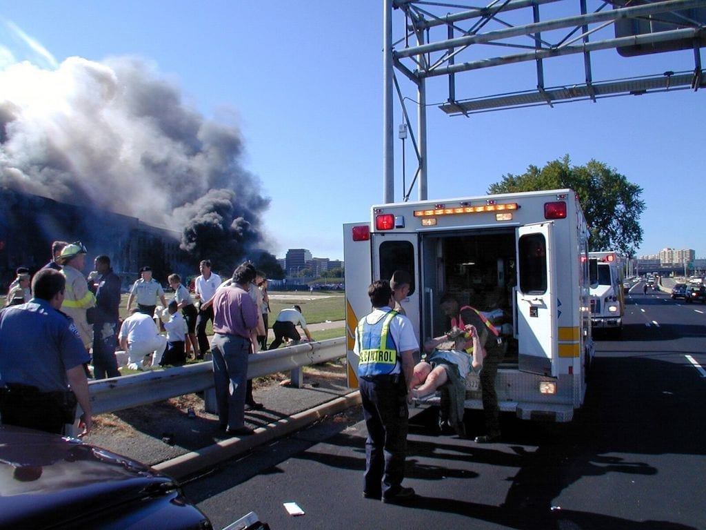 Injured victims of the 9/11 terrorist attack on the Pentagon are loaded onto an ambulance at the medical triage area for transport to a local hospital. U.S. Army photo by George Markfelder