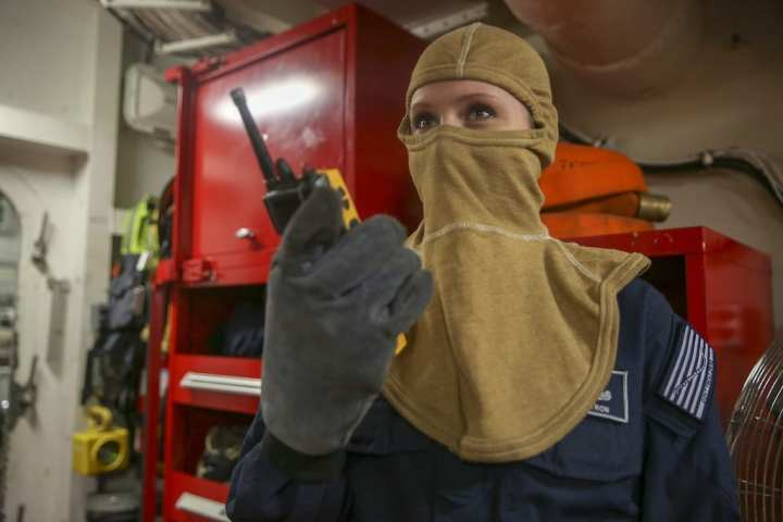 Yeoman 1st Class Kelly Pyron, assigned to U.S. Fleet Forces (USFF) Command, demonstrates the operational wearability of the flame-resistant, two-piece organizational clothing prototype aboard the aircraft carrier USS Harry S. Truman (CVN 75). USFF will conduct a second test of the prototype later this year. The goal of the initiative is to provide a no-cost, safe, and comfortable organizational clothing option to the improved, flame-resistant variant (IFRV) coverall. (U.S. Navy photo by Mass Communication Specialist 2nd Class Stacy M. Atkins Ricks/Released)