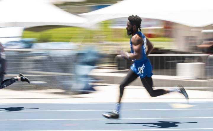 U.S. Air Force veteran Anthony Pearson sprints through the curve during the 200m race at the 2018 Warrior Games at the Air Force Academy in Colorado Springs, Colo., June 6. The Warrior Games were designed to introduce wounded, ill and injured service members to adaptive sports, promote resiliency and encourage camaraderie. (U.S. Air National Guard photo by Senior Airman Leon Bussey.)