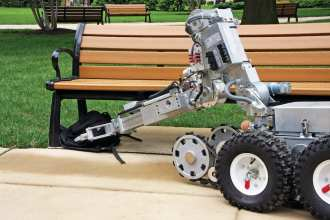 The Pentagon Force Protection Agency's (PFPA) Explosive Ordnance Disposal (EOD) Unit uses one of its robots to move a simulated suspicious package during a presentation in the Pentagon Center Courtyard. PFPA's EOD team is one of the assets the agency has to respond to reported suspicious packages. pentagon force protection agency public affairs photo